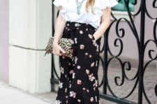 an outfit with printed clutch