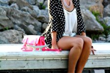 With shorts, white blouse and pink bag
