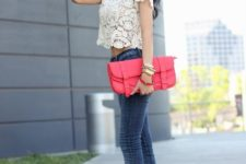 With skinny jeans, red high heels and red clutch