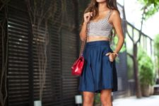 With skirt, heels and red bag