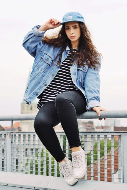 With striped loose shirt, skinny pants, white sneakers and oversized denim jacket