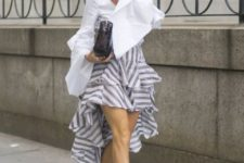 With striped ruffle skirt, white shoes and clutch