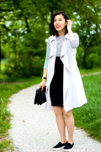 Spring office look with striped shirt, high-waisted skirt, black shoes and clutch