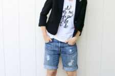 With t-shirt, black blazer, hat and brown sandals