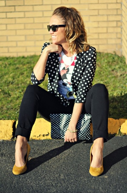 With t-shirt, black pants, yellow pumps and polka dot clutch