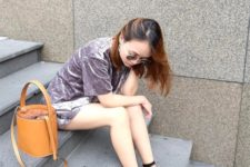 With velvet dress, flat mules and brown bag