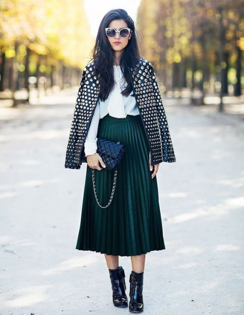 With white blouse, pleated skirt, black boots and black bag