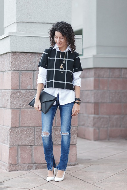 With white button down shirt, distressed jeans, white pumps and black clutch