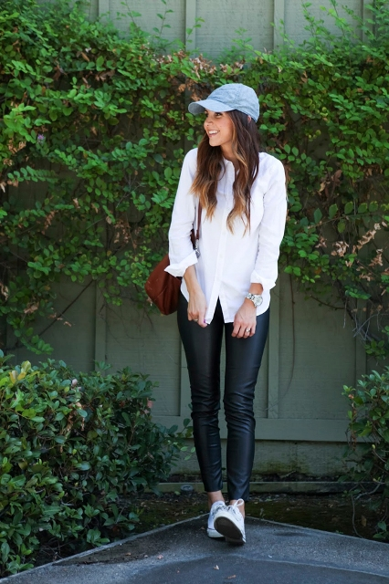With white button down shirt, leather leggings, white shoes and brown bag