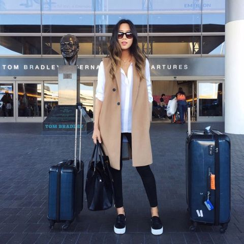 An awesome airport look with white loose shirt, skinny pants, platform shoes and tote