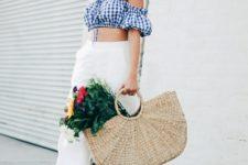 With white pants, high heels and big bag