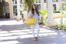 With white pants, sandals and yellow tote