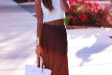 With white shirt and bag