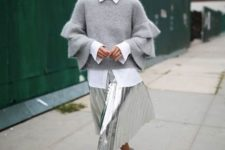 With white shirt, metallic skirt and printed shoes