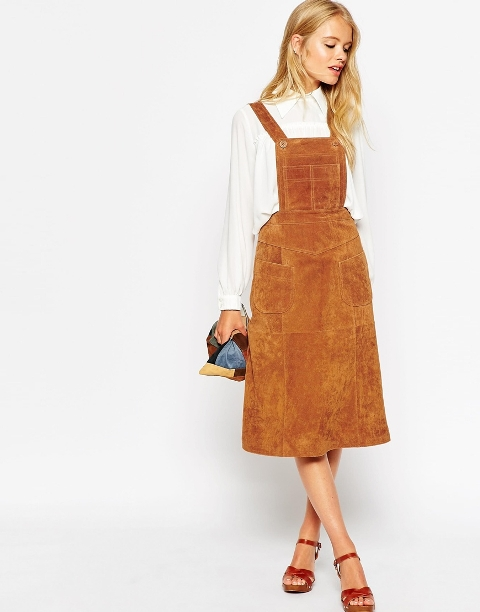 With white shirt, orange sandals and clutch