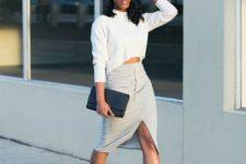 With white sweatshirt, midi skirt, black hat, black high heels and clutch
