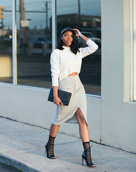 With white sweatshirt, midi skirt, black hat, black high heels and clutch