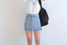 With white t-shirt, denim mini skirt, black bag and cap