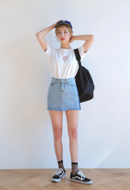 With white t shirt, denim mini skirt, black bag and cap