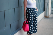 With white t-shirt, white pumps and pink bag
