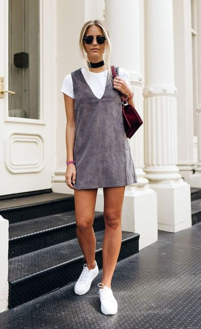 With white t shirt, white sneakers and velvet bag