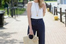 With white top, beige shoes and bag