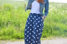 With white top, denim jacket and polka dot pumps