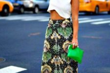 With white top, green clutch and white and black shoes