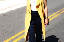 With white top, navy blue flare pants and leopard shoes