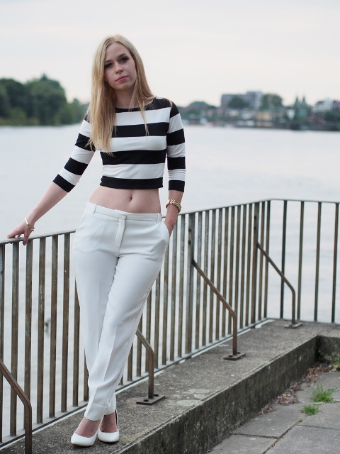 With white trousers and white pumps
