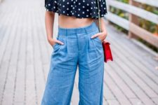 With wide leg denim pants, two colored pumps and red bag