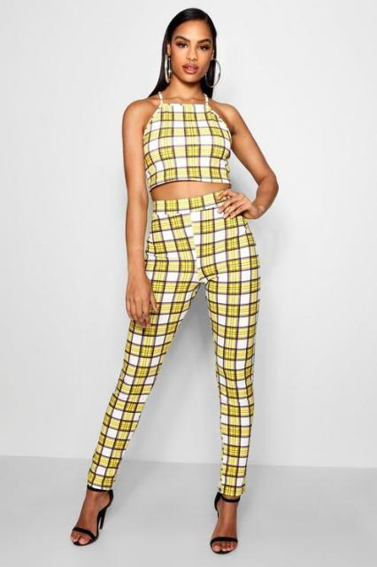 With yellow and white checked skinny pants and black high heels