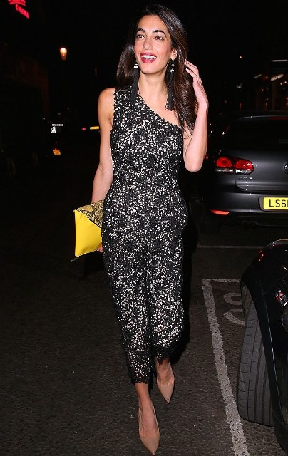 With yellow clutch and beige pumps