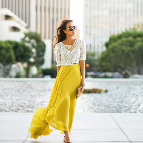 With yellow maxi skirt, leopard clutch and shoes