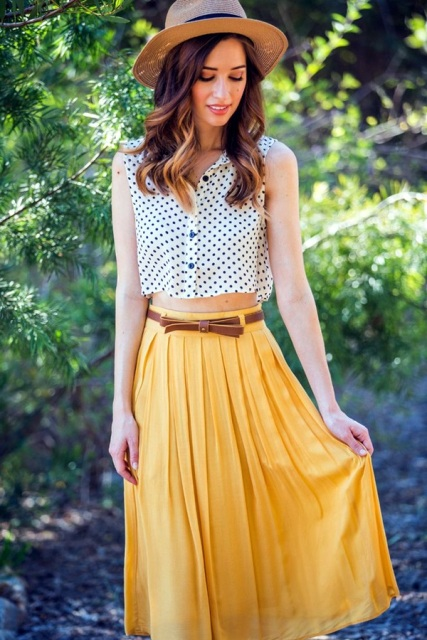 With yellow skirt, brown belt and hat