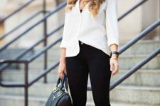 02 a black cropped pants, a white shirt over a black top, black ankle stra shoes and a black bag