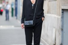 02 a black pantsuit with a black top and checked slipons for a stylish casual work look