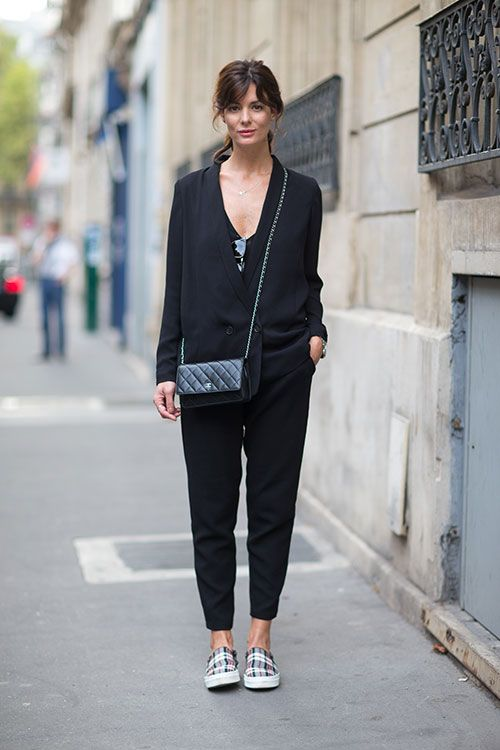 a black pantsuit with a black top and checked slipons for a stylish casual work look