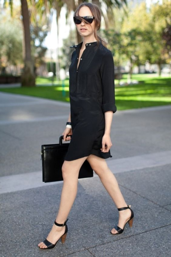 a black shirtdress, black ankle strap heels and a black bag for a simple office look