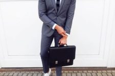 02 a grey suit, a white shirt, a striped tie and white sneakers for a modern feel