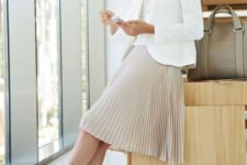 02 a white top, a white jacket, a blush pleated knee skirt, light grey kitten heels