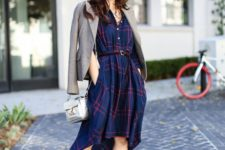 03 a high low blue and red shirtdress with a belt, silver and burgundy shoes, a silver bag and a jacket for a creative job