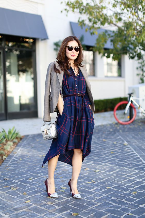 a high low blue and red shirtdress with a belt, silver and burgundy shoes, a silver bag and a jacket for a creative job