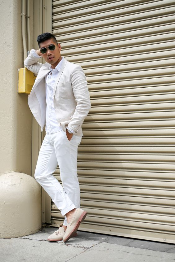 a white suit, a white shirt and neutral suede moccasins for a relaxed and chic look