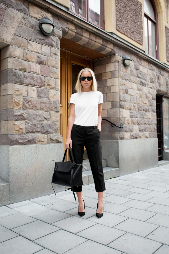 black and white spring office outfit that consists of a white tee, black cropped pants, black heels and a black bag for a casual office look
