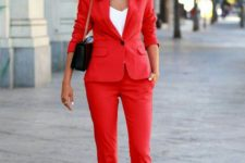03 add color to your work wardrobe with a red pantsuit, a white top, printed shoes and a black bag