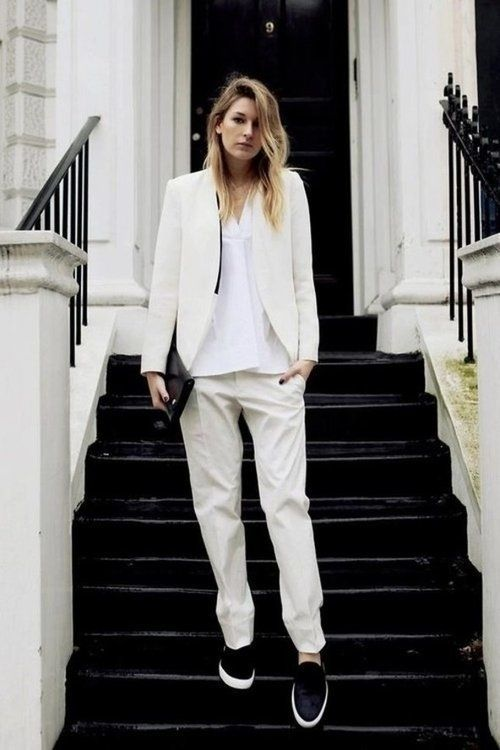 a creamy pantsuit, a white button down and black slipons for minimalist chic