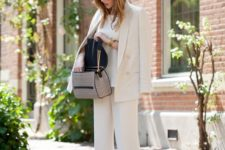 a creamy wide leg pantsuit, a white top and a printed bag for a luxurious feel
