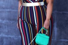 04 a striped jumpsuit with spaghetti straps, a very daring V-neckline and a bold green bag for a summer party