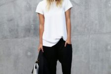 04 a white tee, black pants, black mules and a black jacket for a minimalist chic office look